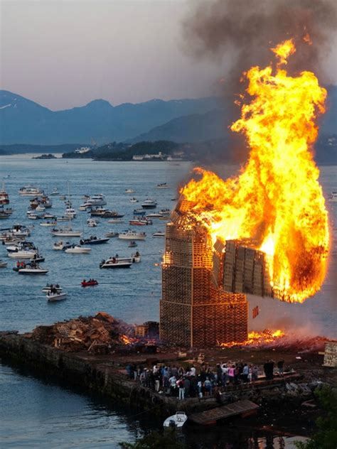 World's biggest bonfire fueled by a 130-foot-tall stack of