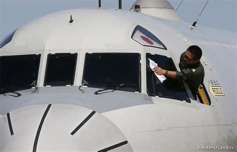 Chinese Plane Spots Objects in Search Area as Weather